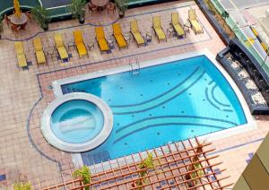 A view of the pool at Dunes Hotel Apartment Oud Metha or nearby
