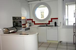 A kitchen or kitchenette at Exclusive Central Apartment