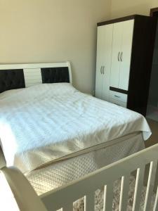 A bed or beds in a room at Casa de aluguel