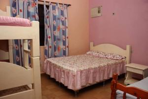 A bed or beds in a room at chácara solar das águas