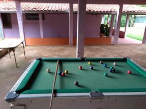 A pool table at chácara solar das águas