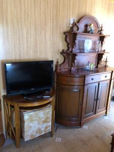 Телевизор и/или развлекательный центр в Апартаменты Шале