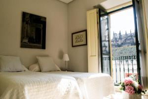 A bed or beds in a room at Casa Torre Giralda