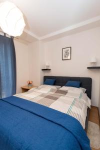 Krevet ili kreveti u jedinici u objektu Apartman Lux