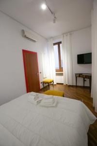 Letto o letti in una camera di Toledo Corner by Dimorra