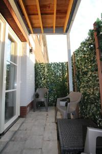 A balcony or terrace at 4 persons City Apartment