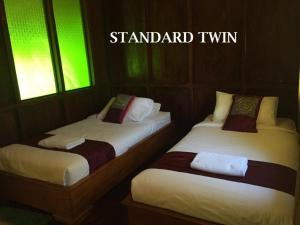 A bed or beds in a room at Kampoeng Joglo Ijen