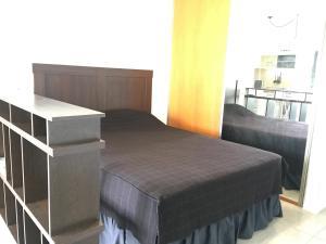 Una cama o camas en una habitación de Exclusivo departamento en Palermo