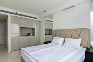 מיטה או מיטות בחדר ב-מלון דירות סי וויו