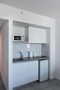 מטבח או מטבחון ב-מלון דירות סי וויו