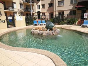The swimming pool at or near Gold Coast Surfers' Paradise Central Riverview apartment