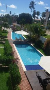 The swimming pool at or near Porto Plaza Cupe Beach