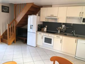 A kitchen or kitchenette at Gite Ferme de la Place