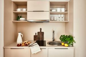 A kitchen or kitchenette at City Comfort Aparthotel