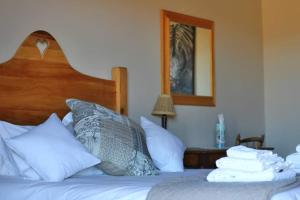 A bed or beds in a room at Ribboksfontein Guest Farm