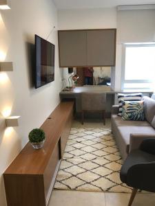 A kitchen or kitchenette at Kit Net Studio, moderna e aconchegante.