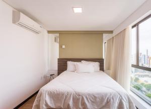A bed or beds in a room at Apart Hotel em Boa Viagem