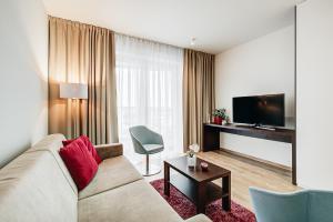 Телевизор и/или развлекательный центр в Exclusive Apartments in Luka
