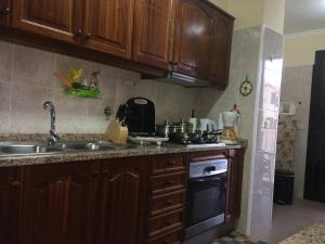A cozinha ou kitchenette de Palheiro Residence