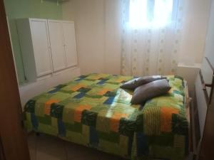 A bed or beds in a room at Casa vacanze Alfano