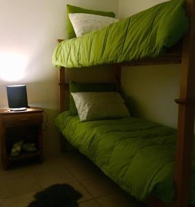 Una cama o camas cuchetas en una habitación  de RUCA VARAS