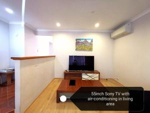 A television and/or entertainment center at Cosy easy access home near Perth CBD and Fremantle