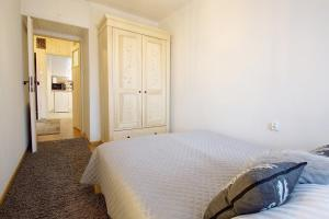 A bed or beds in a room at Apartament Regionalny Centrum