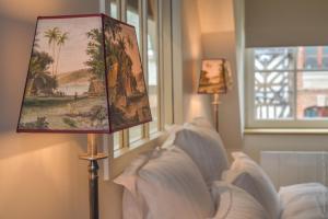 Un ou plusieurs lits dans un hébergement de l'établissement La Maison de Pierre et Valérie St Leonard Honfleur