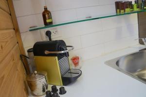 A kitchen or kitchenette at Luxury Beach Suite