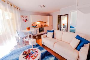 Ein Sitzbereich in der Unterkunft The Princess Monac'home
