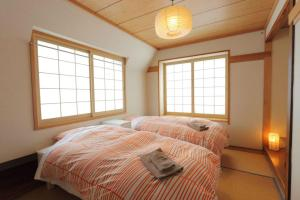 A bed or beds in a room at Nozawa Central