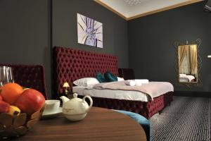 A bed or beds in a room at Main Square Residence