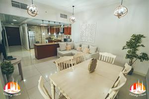 A restaurant or other place to eat at A C Pearl Holiday Homes - Pinnacle of Marina