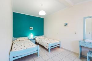 A bed or beds in a room at Panorama Apartments