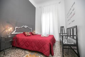 A bed or beds in a room at Les Maisons de Genes