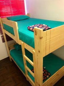 A bunk bed or bunk beds in a room at Departamento completo en San Borja