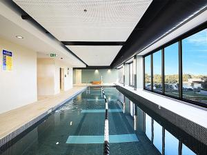 The swimming pool at or near Airport 2BR Family Apartment