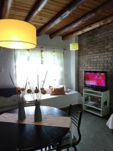 Una cama o camas en una habitación de Alójate Accommodation D3