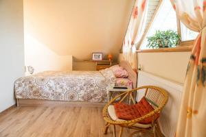 A bed or beds in a room at Kranto Vila