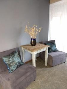 Un lugar para sentarse en Alójate Accommodation D4