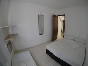 A bed or beds in a room at Porto Residence