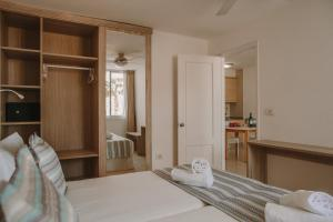 A bed or beds in a room at Playa Del Sol - Adults Only
