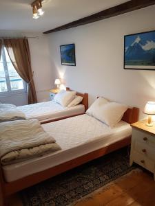 Ein Bett oder Betten in einem Zimmer der Unterkunft Quai Peree Apartement