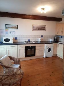 Küche/Küchenzeile in der Unterkunft Quai Peree Apartement
