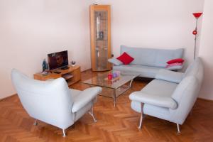 Ein Sitzbereich in der Unterkunft Nadalina Apartment