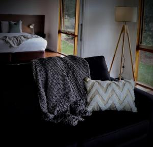 A bed or beds in a room at Yering Gorge Cottages