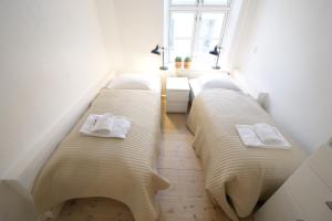 A bed or beds in a room at Stroget Main shopping Street