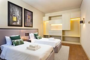 A bed or beds in a room at Lisbon Finestay 8 Building Apartments