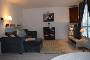 Modern and Homely 2 Bed Flat in Whitechapel tesisinde bir oturma alanı