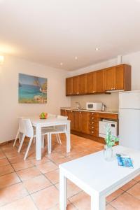 Een keuken of kitchenette bij Pierre & Vacances Villa Romana